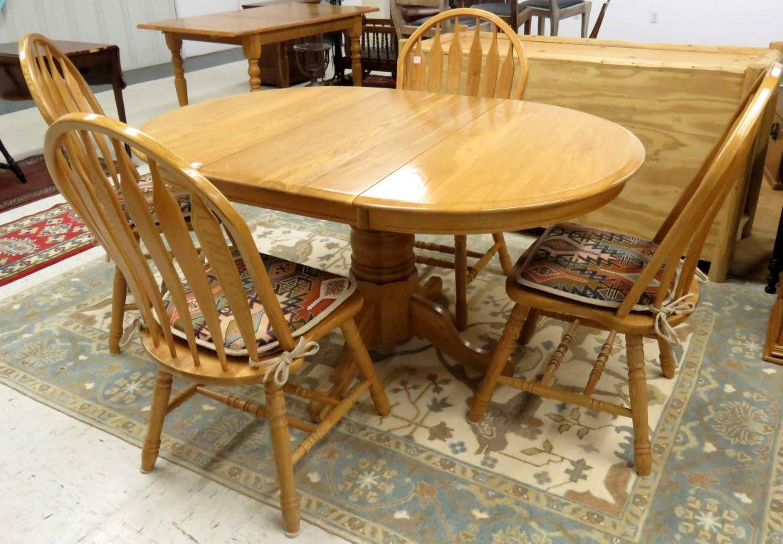 CARVED OAK PEDESTAL BASE EXTENSION DINING TABLE WITH