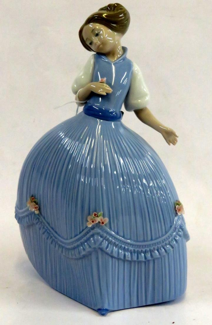 LLADRO DECORATED PORCELAIN FIGURE OF A GIRL, #50.