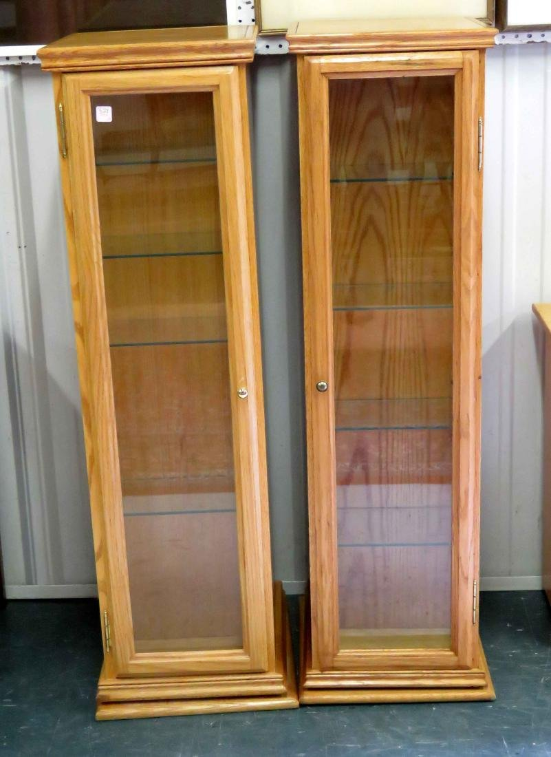 PAIR OAK SWIVEL CD CABINETS. HEIGHT 48 1/2""