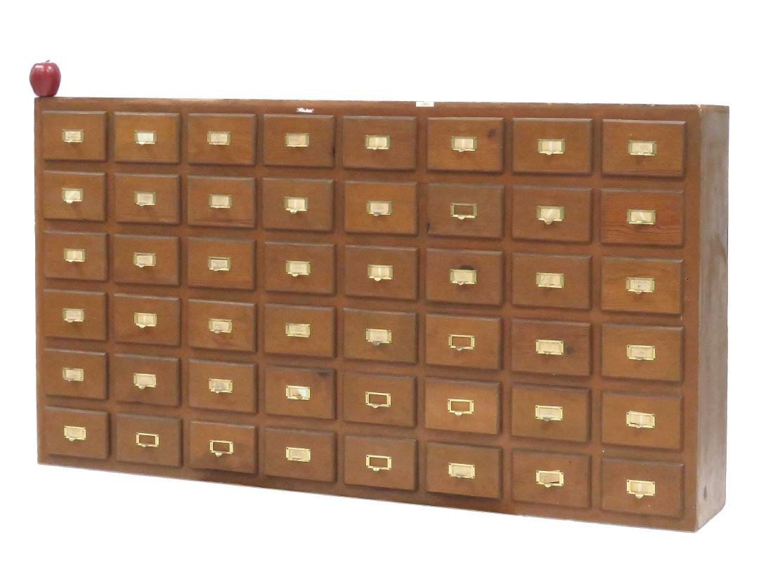 "PINE 48-DRAWER CABINET. HEIGHT 36""; WIDTH 66""; DEPTH"