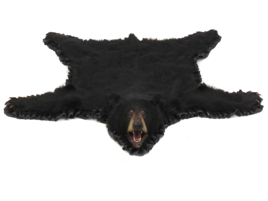 NORTH AMERICAN BLACK BEAR SKIN RUG WITH HEAD AND CLAWS.