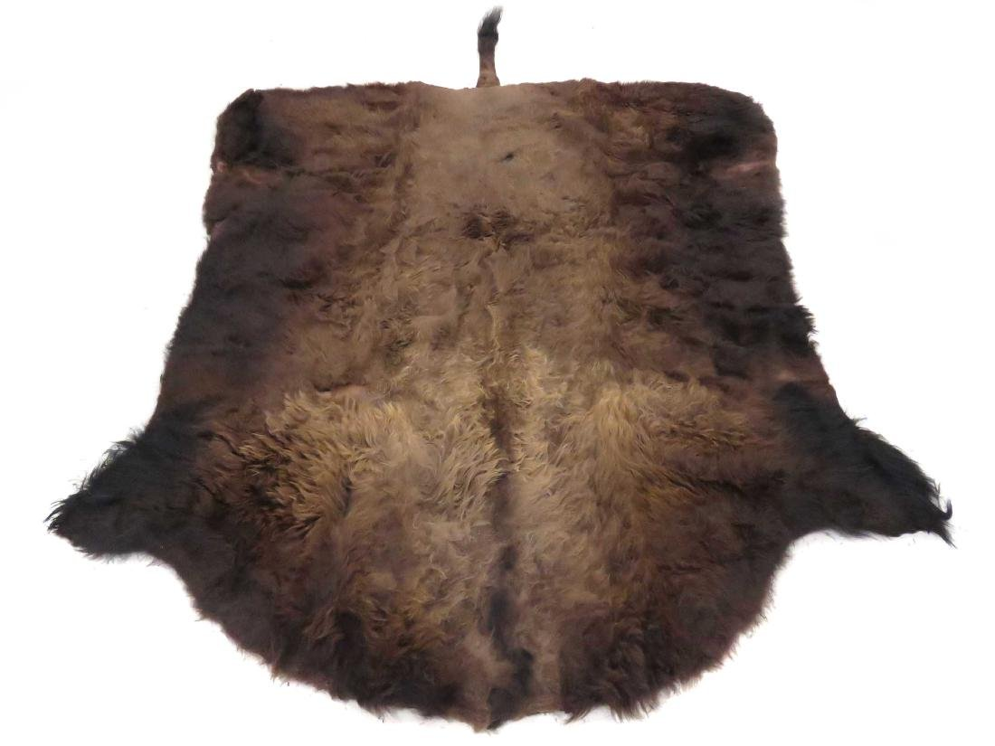 "BUFFALO SKIN RUG (BACKED). 8'3"" X 9'"