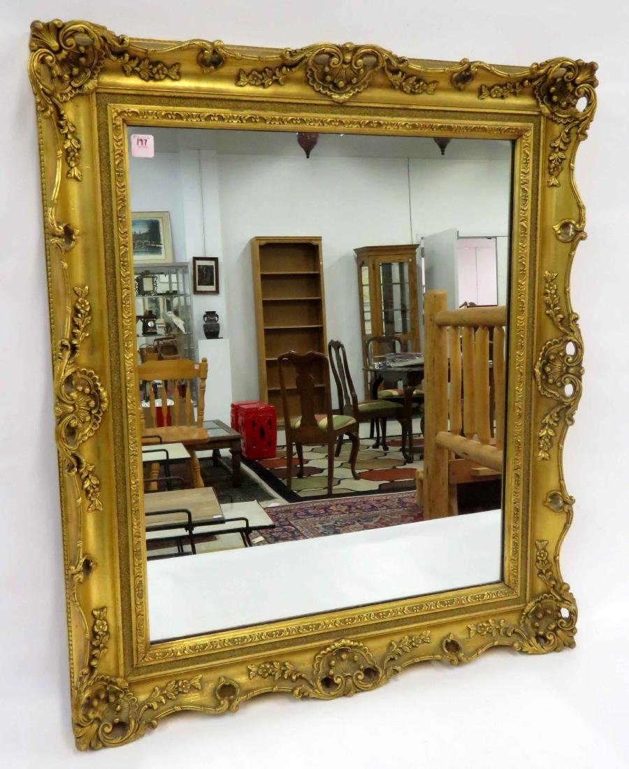 """FRENCH STYLE CARVED AND GILT FRAMED MIRROR. 34 X 28"""""""