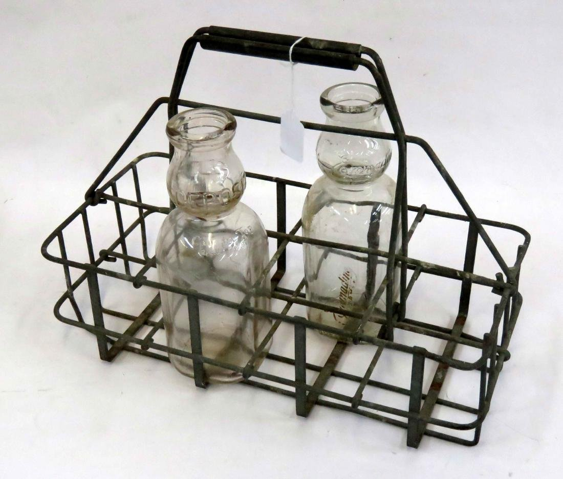 LOT INCLUDING MILKMAN'S BOTTLE CARRIER AND BOTTLES
