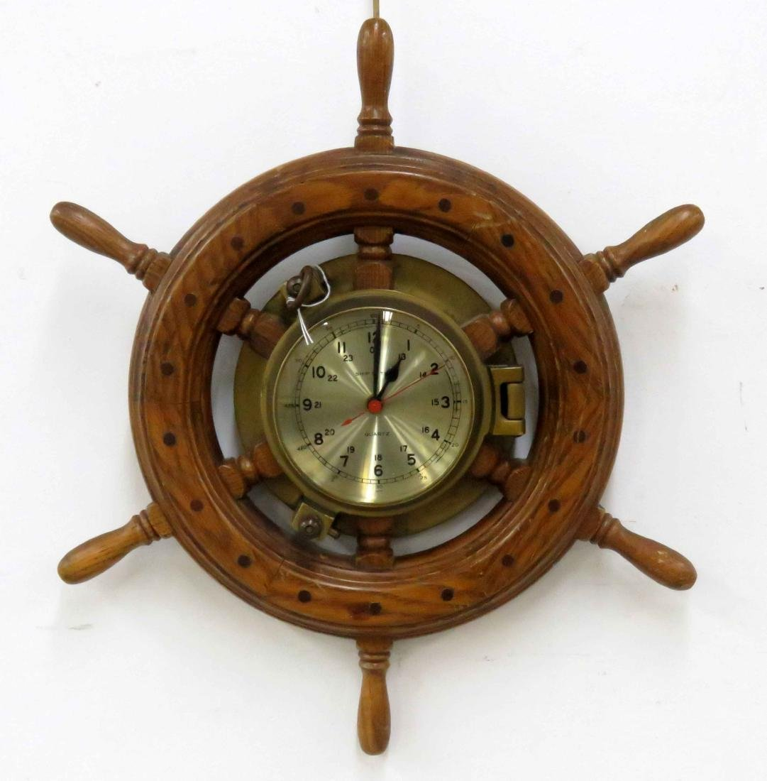 OAK AND BRASS QUARTZ SHIP'S WHEEL CLOCK. DIAMETER 19""