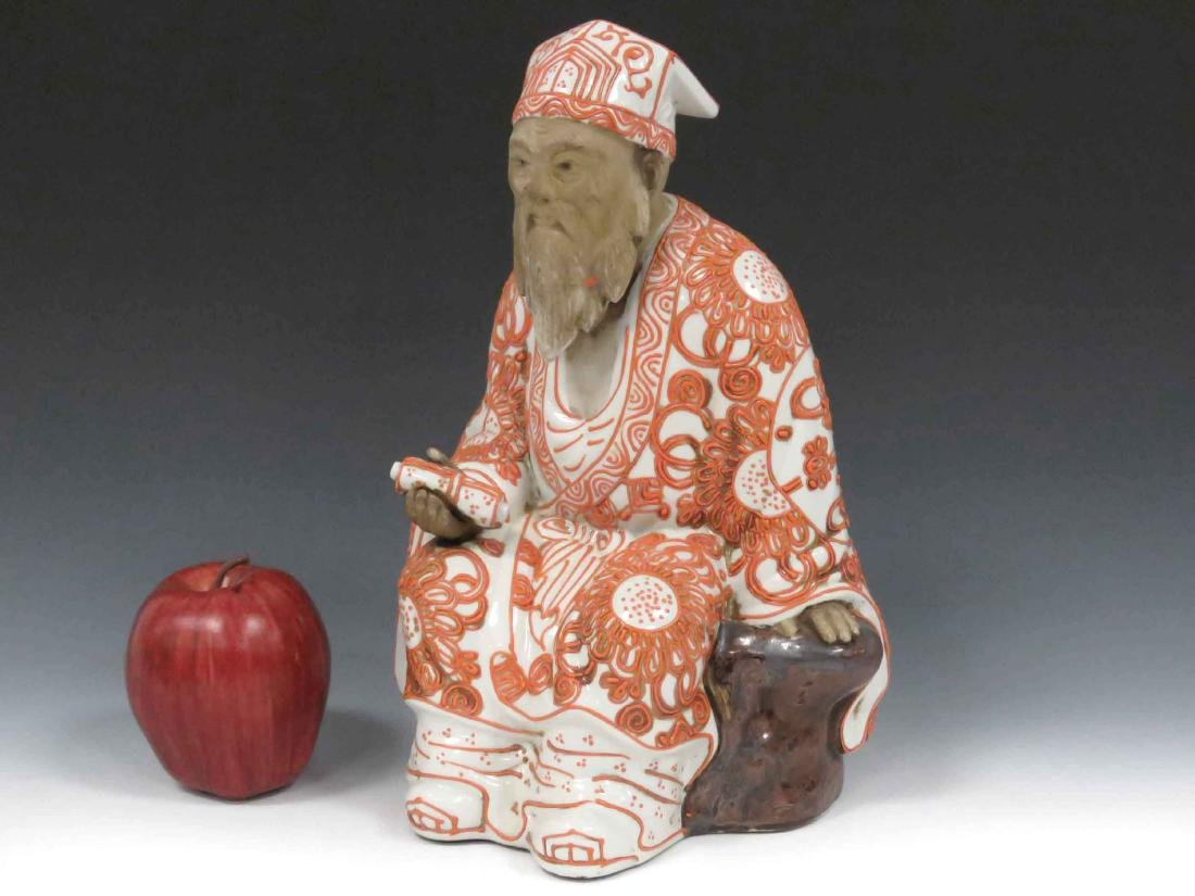 CHINESE DECORATED PORCELAIN FIGURE OF A SEATED LOHAN.