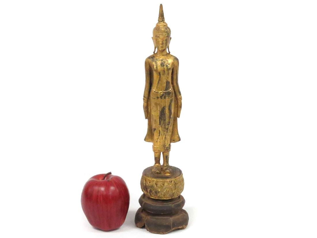 THAI CARVED AND GILT STANDING BUDDHA, 19TH CENTURY.