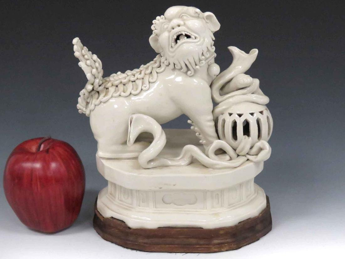 CHINESE BLANC DE CHINE PORCELAIN FOO DOG WITH STAND.
