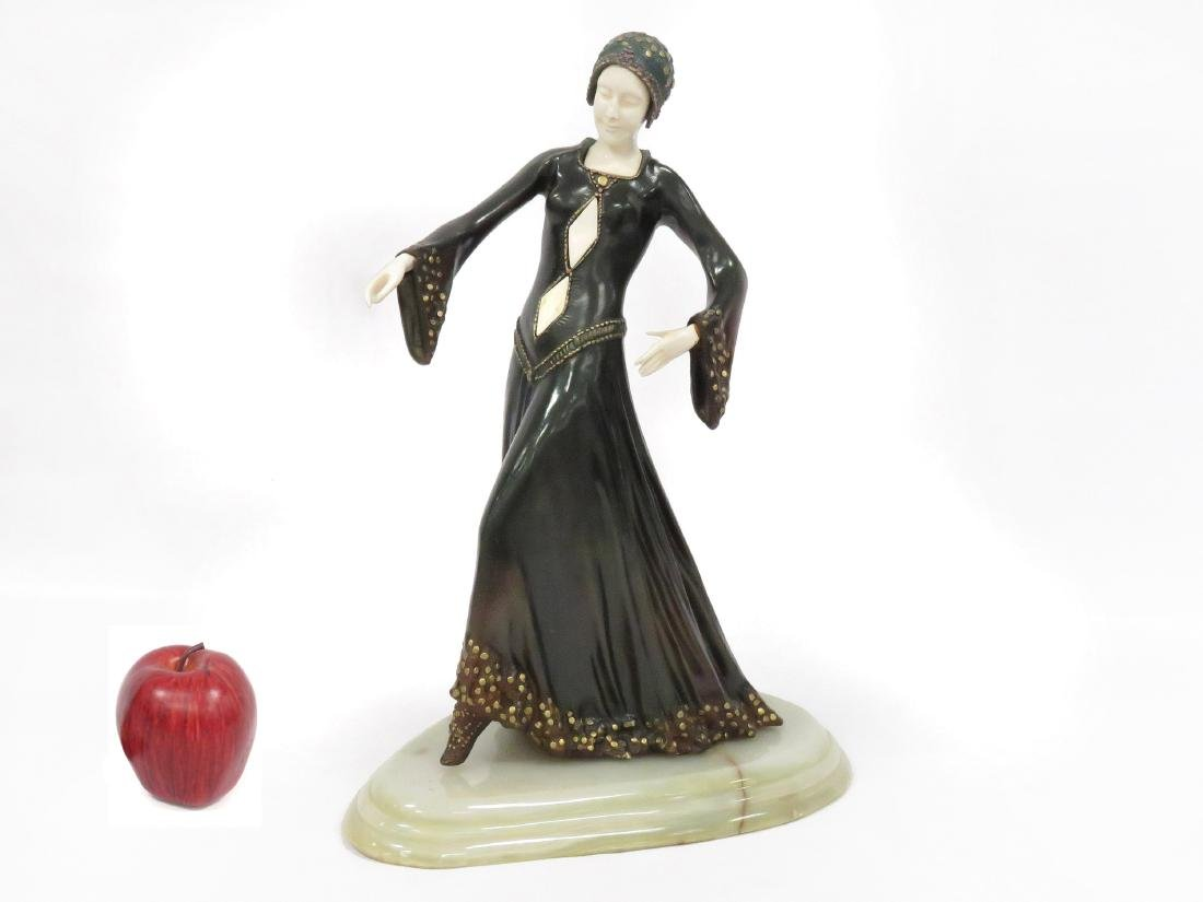 AFTER CHIPARUS, POLYCHROMED BRONZE OF A WOMAN, SIGNED.