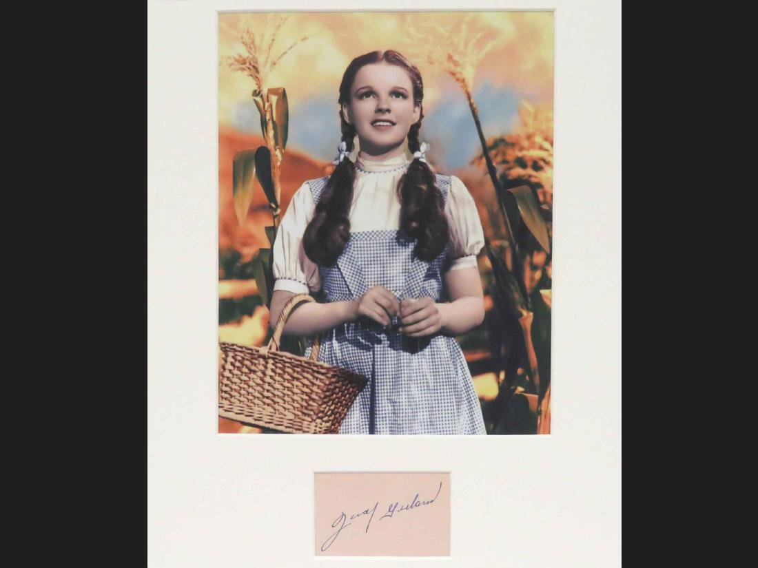 JUDY GARLAND (AMERICAN ACTOR 1922-1969), AUTOGRAPH CUT.