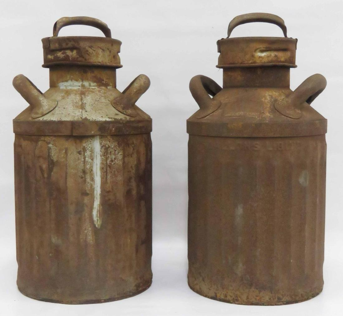 PAIR RUSTED MILK CANS