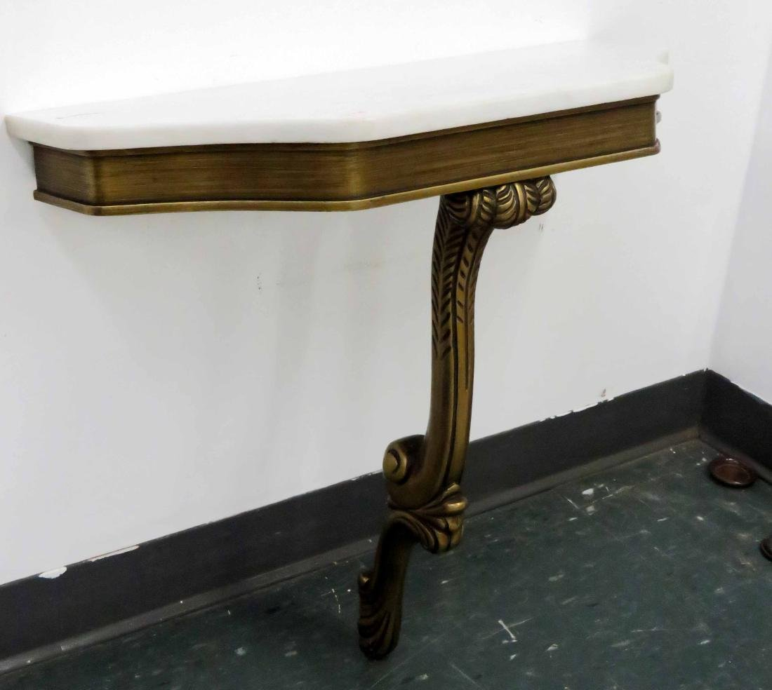 REGENCY STYLE CARVED AND GILT CONSOLE WITH MARBLE TOP.