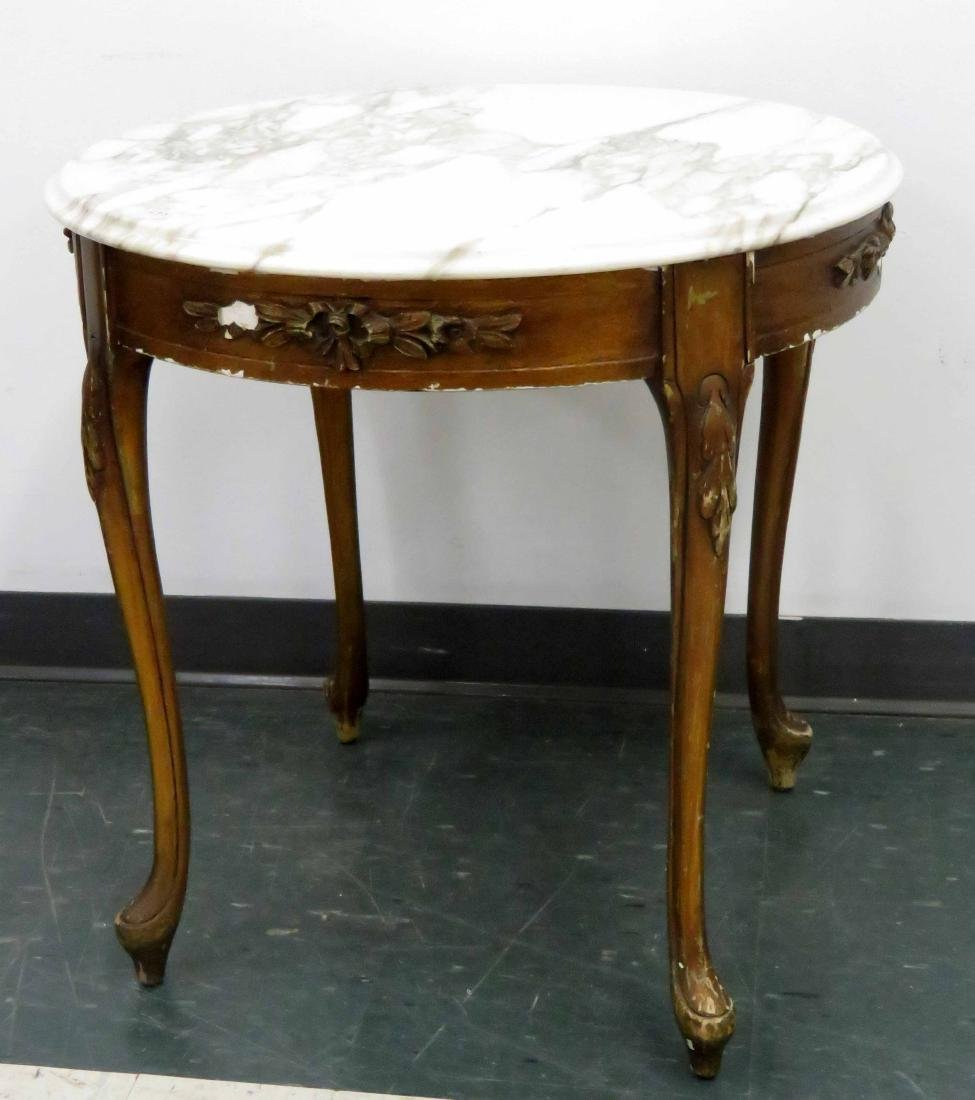 FRENCH STYLE CARVED MAHOGANY MARBLE-TOP ROUND TABLE.