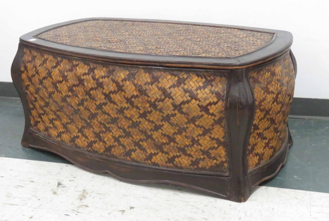"""WOVEN BAMBOO COVERED TRUNK. HEIGHT 19""""; LENGTH 42"""""""