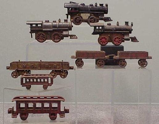 2007: LOT (8) ASSORTED CAST IRON TRAINS