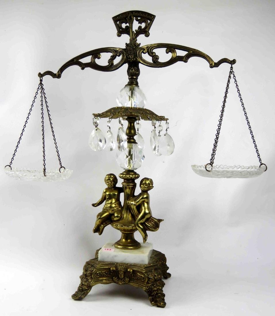 CLASSICAL STYLE GILT METAL FIGURAL DECORATIVE SCALE.