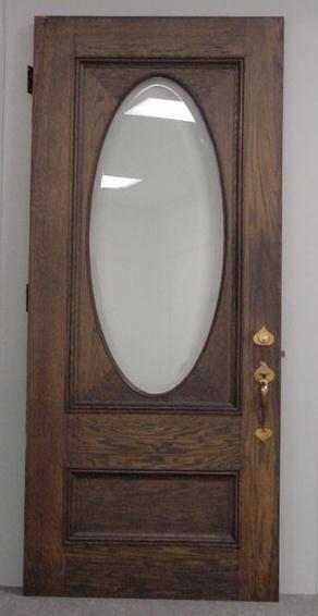 24: EDWARDIAN OAK/BEVELED GLASS ENTRANCE DOOR