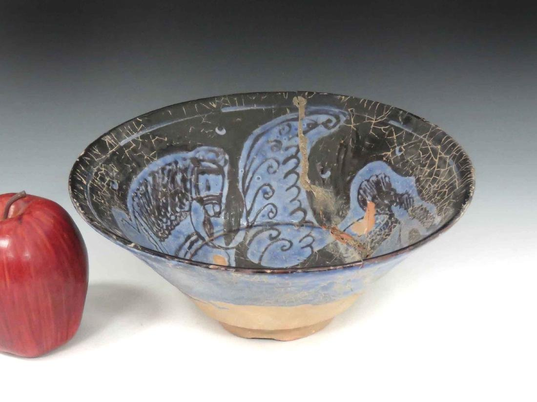 ISLAMIC DECORATED POTTERY BOWL WITH FLYING HORSE.
