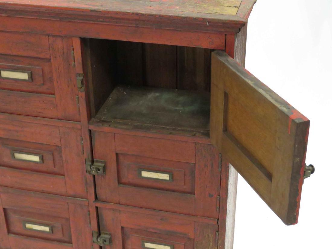 OAK 10-DOOR CABINET WITH RED WASH, 19TH CENTURY. HEIGHT - 2