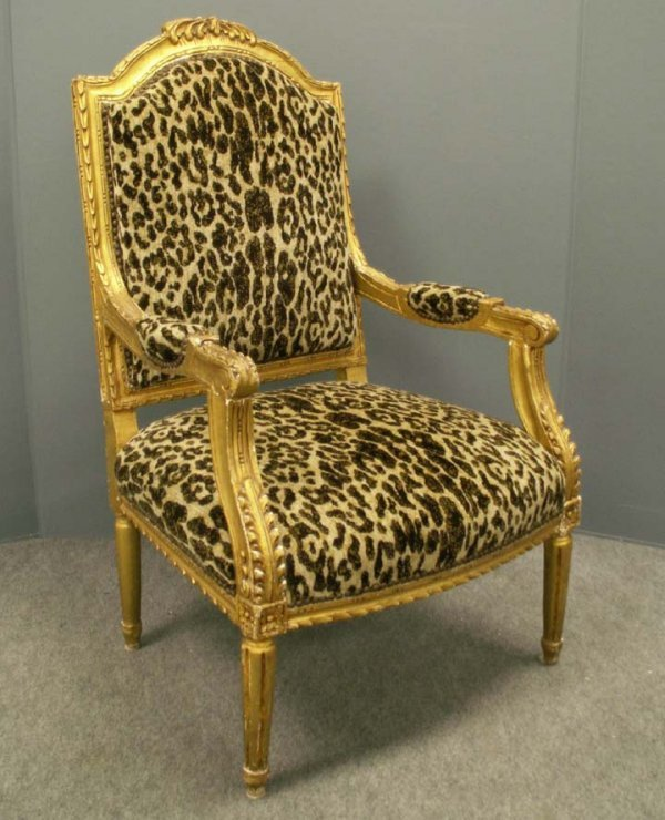 2011: FRENCH STYLE CARVED AND GILT OPEN ARMCHAIR