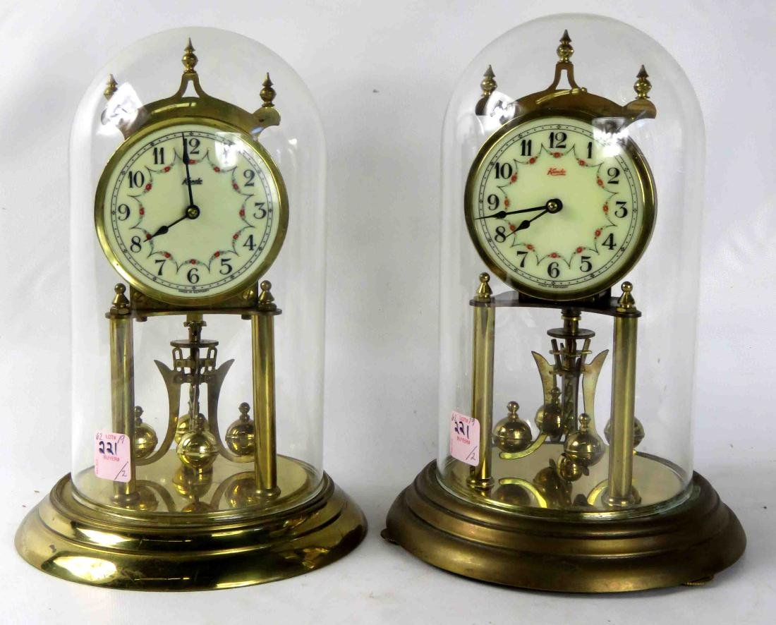LOT (2) KUNDO BRASS ROTARY DOME CLOCKS. HEIGHT 11""