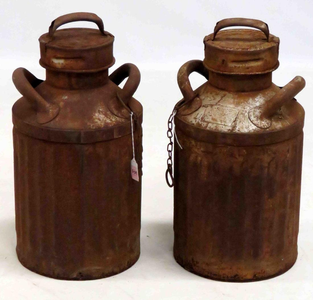 """PAIR RUSTED MILK CANS. HEIGHT 21"""""""