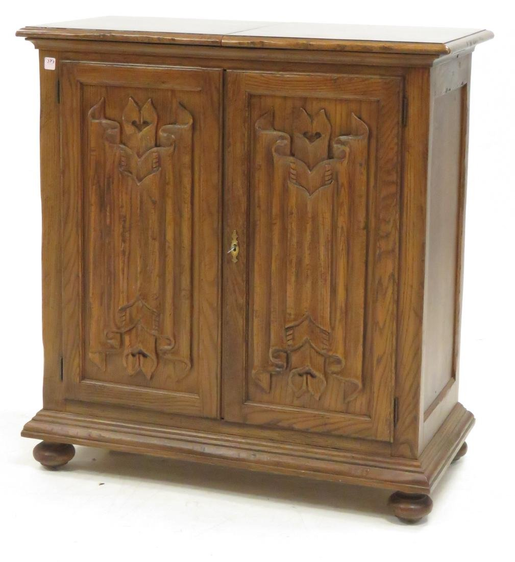 "BAKER FURNITURE CO. CARVED OAK BAR CABINET. HEIGHT 39"";"