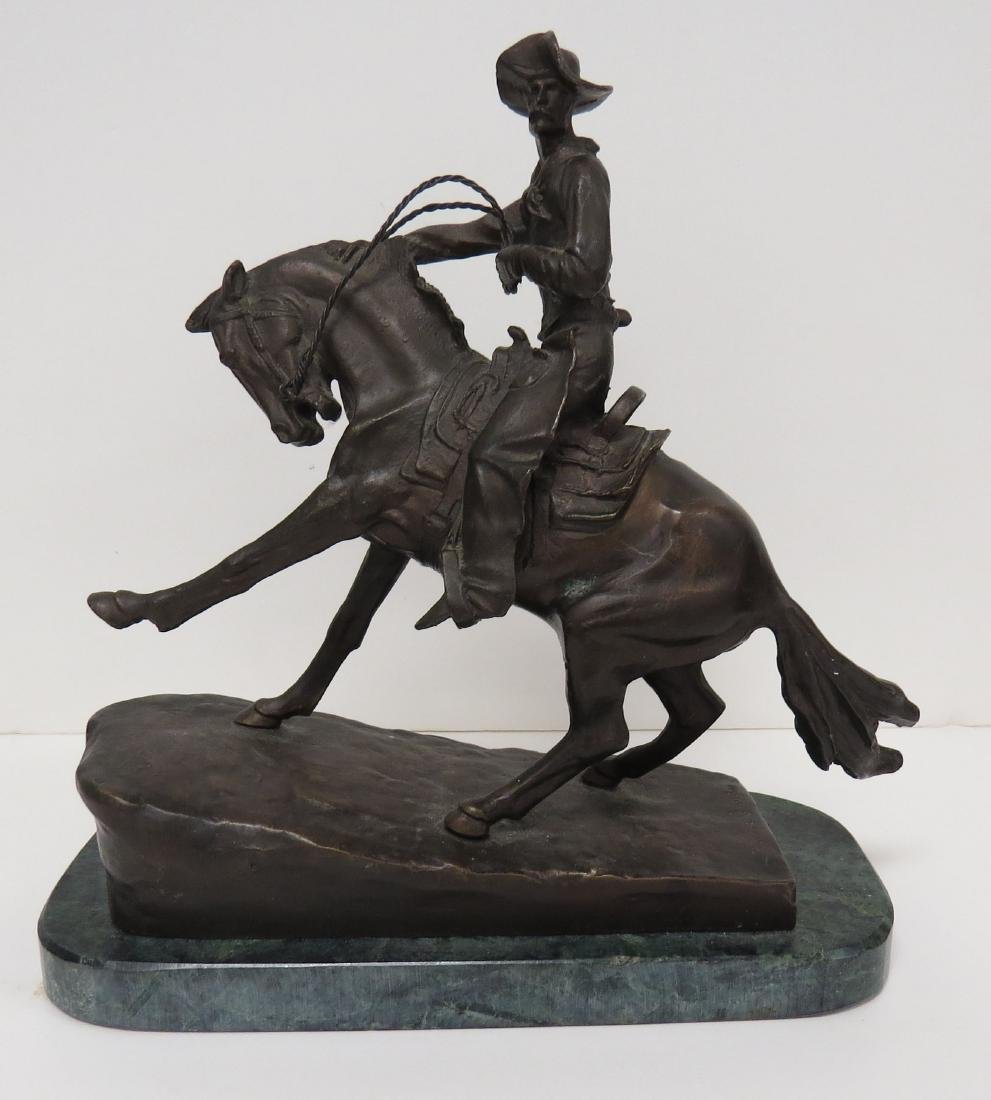 AFTER FREDERIC REMINGTON, BRONZE COWBOY, SIGNED. HEIGHT