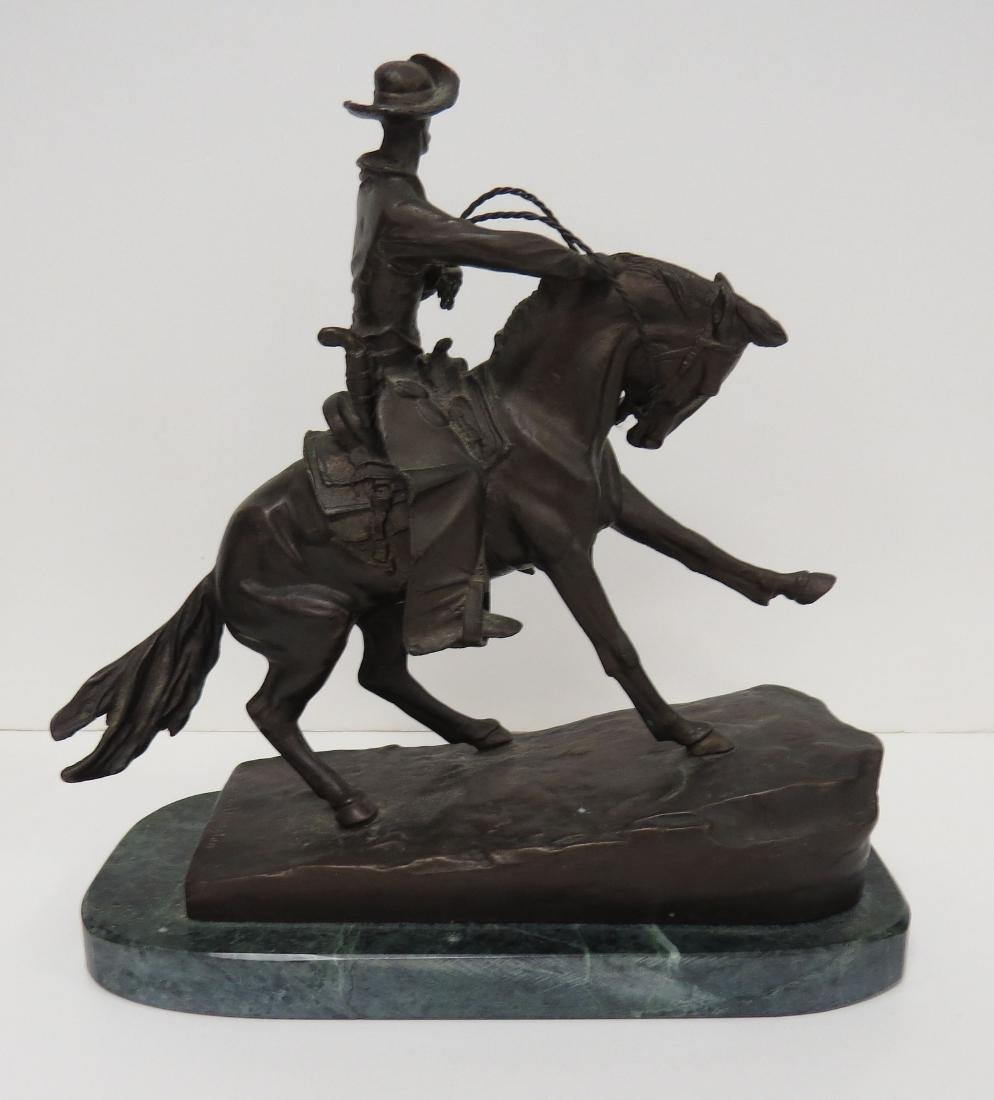 AFTER FREDERIC REMINGTON, BRONZE COWBOY, SIGNED. HEIGHT - 2