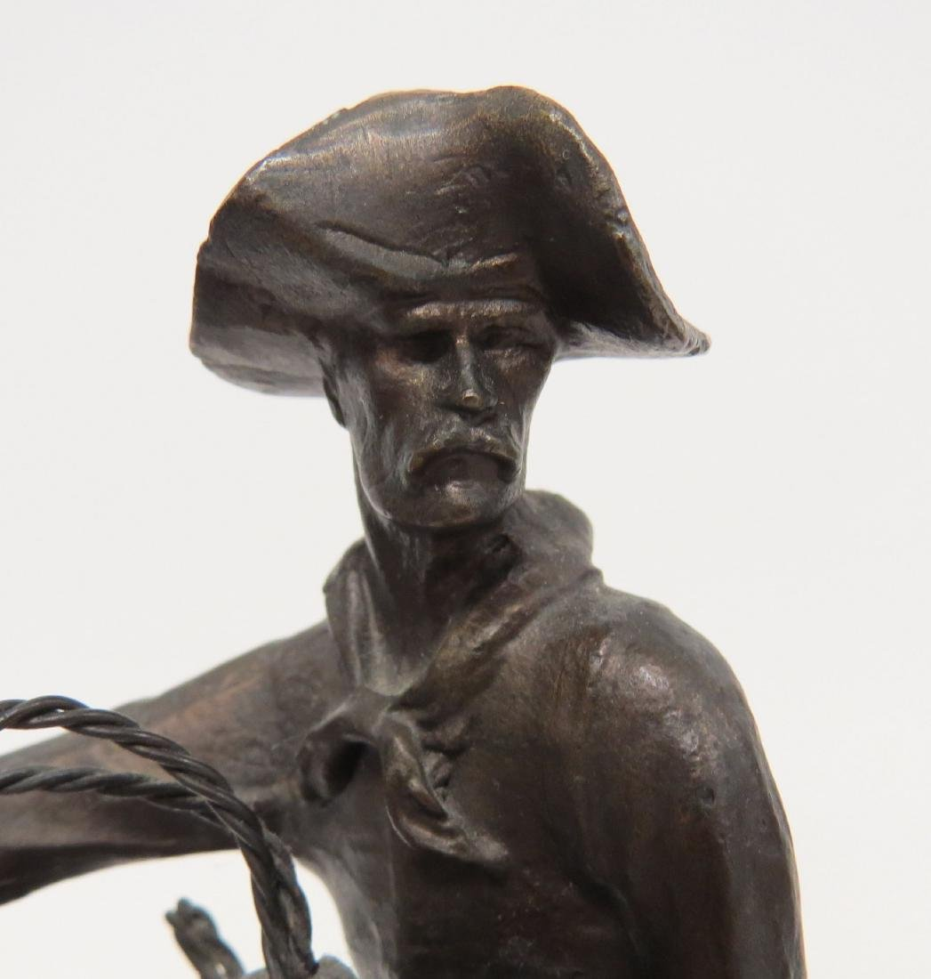 AFTER FREDERIC REMINGTON, BRONZE COWBOY, SIGNED. HEIGHT - 4