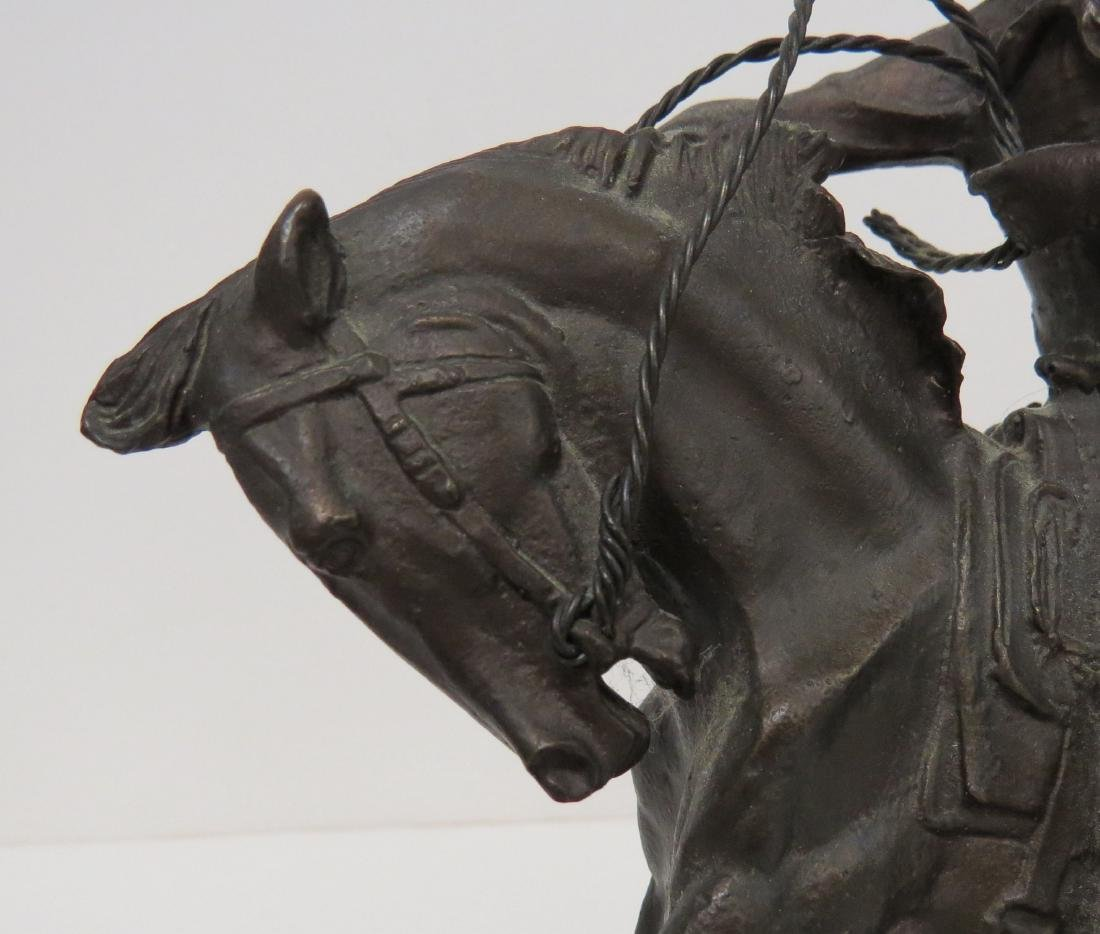 AFTER FREDERIC REMINGTON, BRONZE COWBOY, SIGNED. HEIGHT - 5