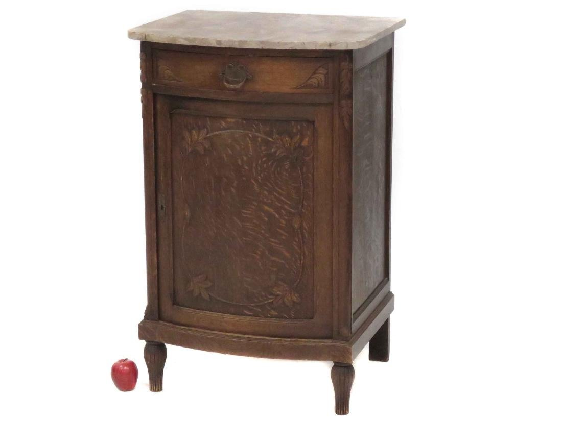 FRENCH ART NOUVEAU CARVED OAK CABINET WITH MARBLE-TOP.