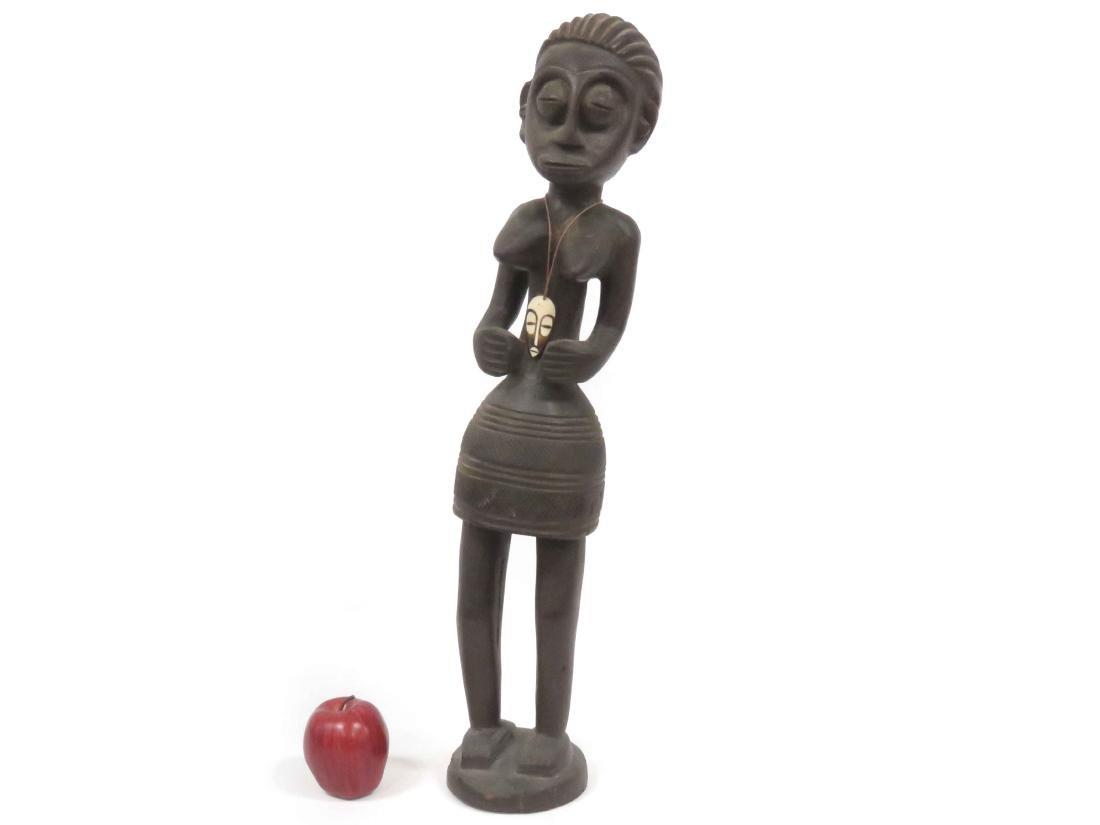 YORUBA, NIGERIA, CARVED FEMALE FIGURE WITH SKIRT AND