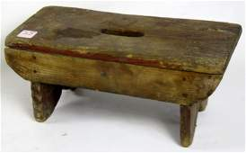 CARVED PINE MILKING STOOL WITH BOOT JACK ENDS. HEIGHT