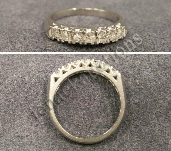 1022: PLATINUM AND DIAMOND SINGLE-CUT 7-STONE RING