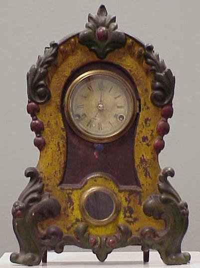 2022: PAINTED IRON FRONT SHELF CLOCK, TIME &