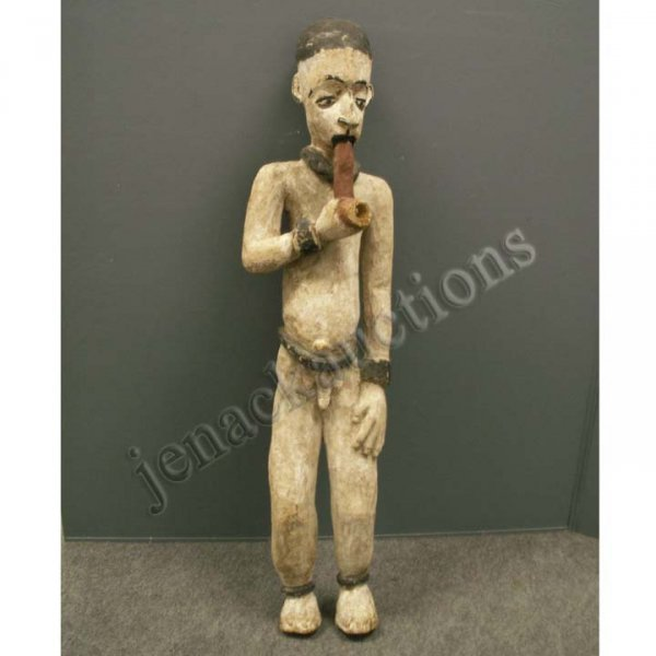 2007: YORUBA CARVED AND PAINTED MALE FIGURE WITH PIPE
