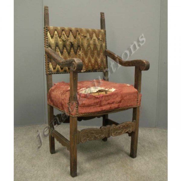 1011: CONTINENTAL CARVED WALNUT ARMCHAIR