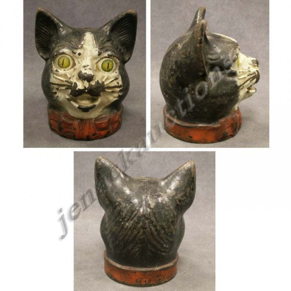 1077: VINTAGE PAINTED CAST IRON HEAD OF A CAT