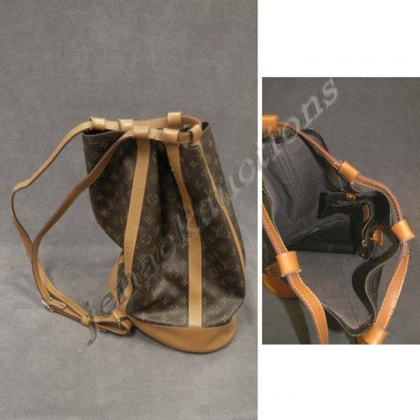 1009: LOUIS VUITTON DRAWSTRING SHOULDER BAG