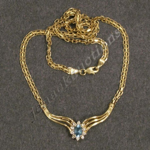 1020: 14K YELLOW GOLD CHAIN WITH BLUE TOPAZ AND DIAMOND