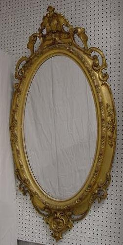 11: VICTORIAN CARVED/GILT OVAL MIRROR