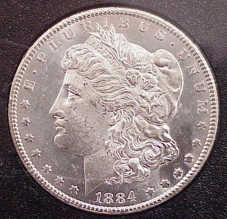1014: 1884 CC UNC SILVER DOLLAR, CASED