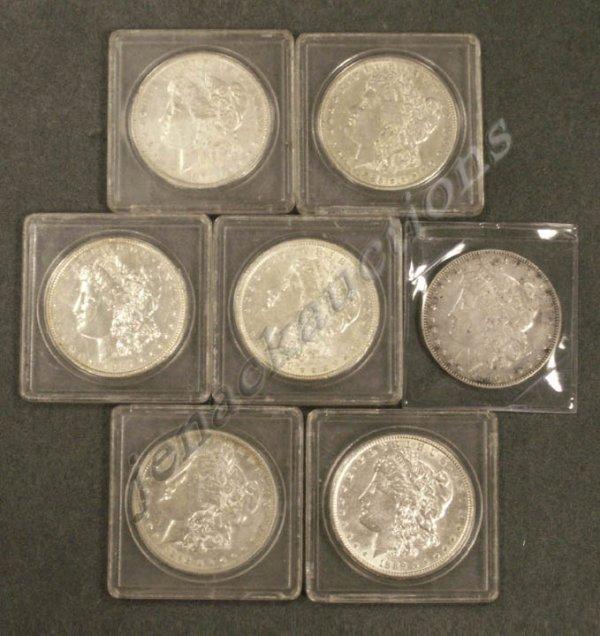 6: LOT (7) ASSORTED U.S. MORGAN SILVER DOLLAR COINS