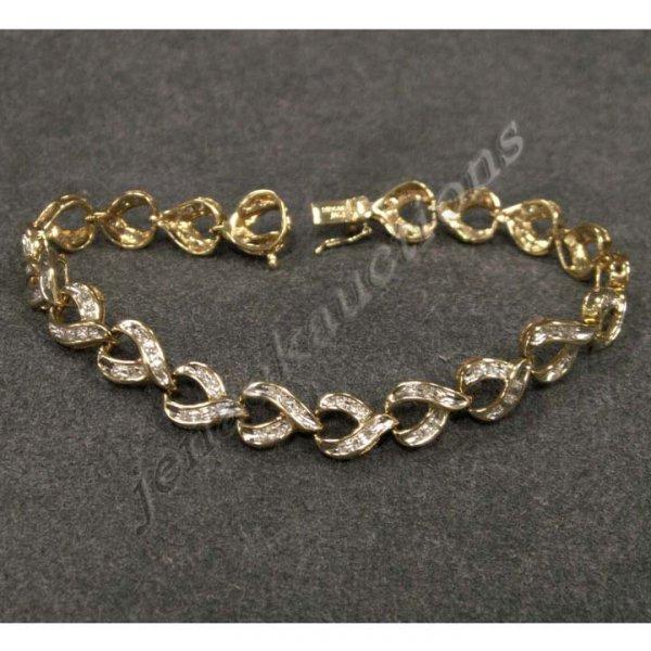 2014: 14K YELLOW GOLD DIAMOND BRACELET