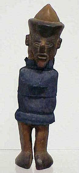 4: TEKE CARVED POWER FIGURE