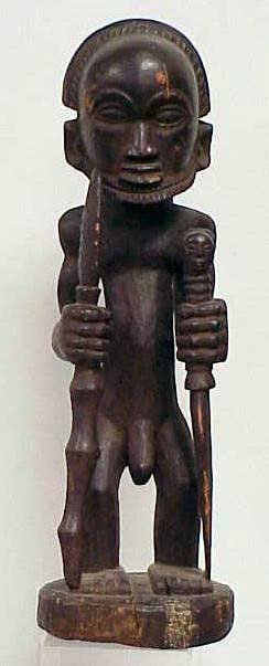 16: LUBA CARVED MALE FIGURE WITH WEAPONS
