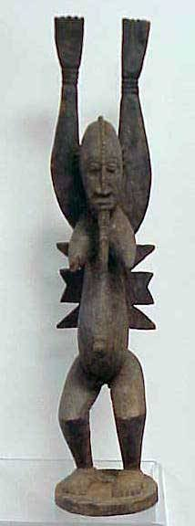 22: DOGON CARVED DANCING FEMALE