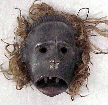 24: CAMEROON CARVED MASK WITH RAFFIA