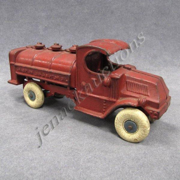 13: VINTAGE CHAMPION CAST IRON GAS & MOTOR OIL TANKER